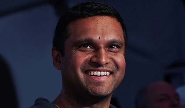 Photograph of a man smiling.